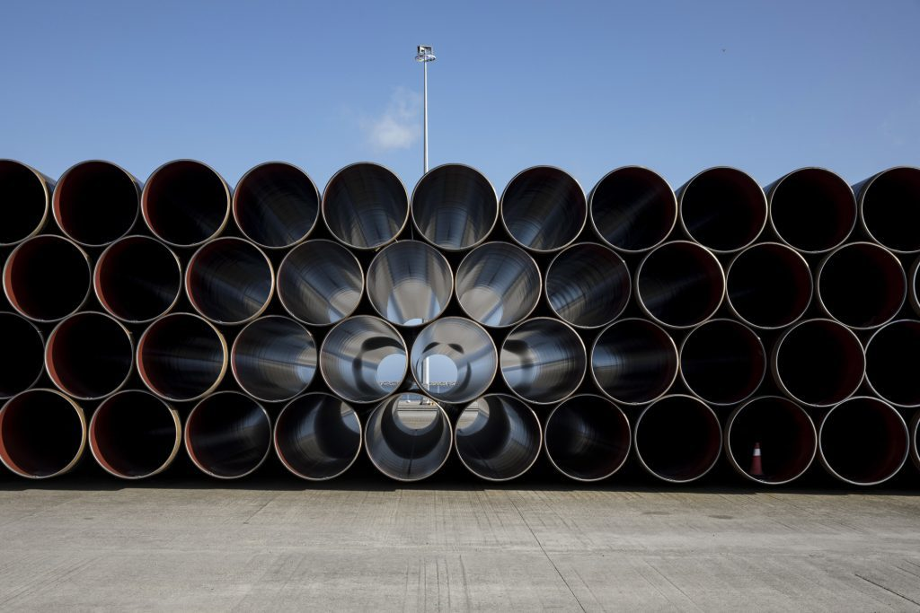 Pipe sections for the Trans Adriatic gas pipeline sit on the dockside at the cargo port of Alexandroupolis, Greece, on Feb. 23, 2017. The Trans Adriatic Pipeline AG (TAP) will transport Caspian natural gas to Europe crossing Northern Greece, Albania and the Adriatic Sea coming ashore in Southern Italy to connect the Italian gas network to the Trans Anatolian Pipeline (TANAP). Photographer: Konstantinos Tsakalidis/Bloomberg