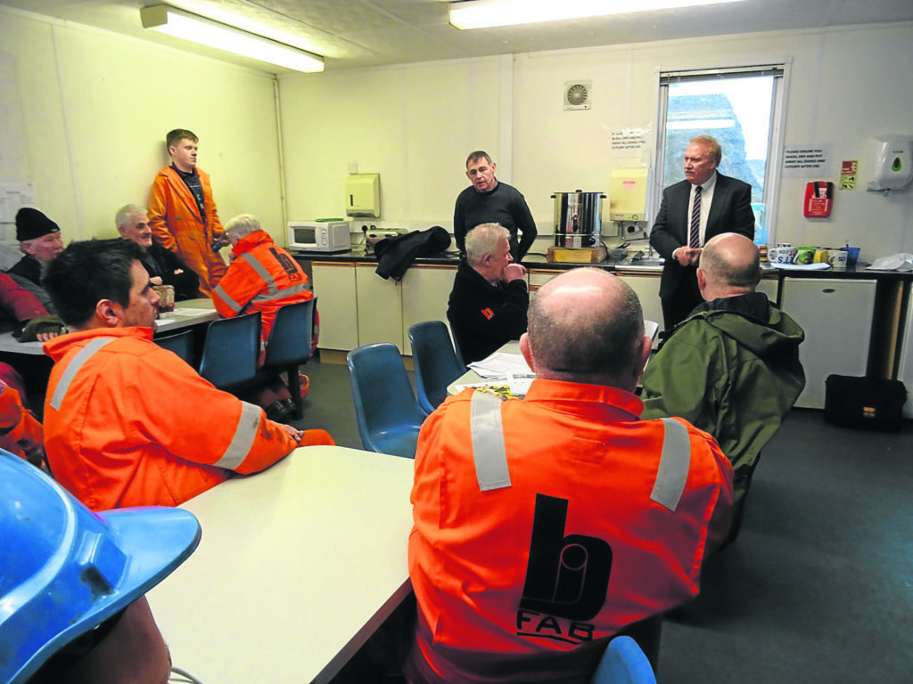 The GMS's Alan Ritchie (wearing tie) speaks to Arnish BiFab workers but there is little optimism