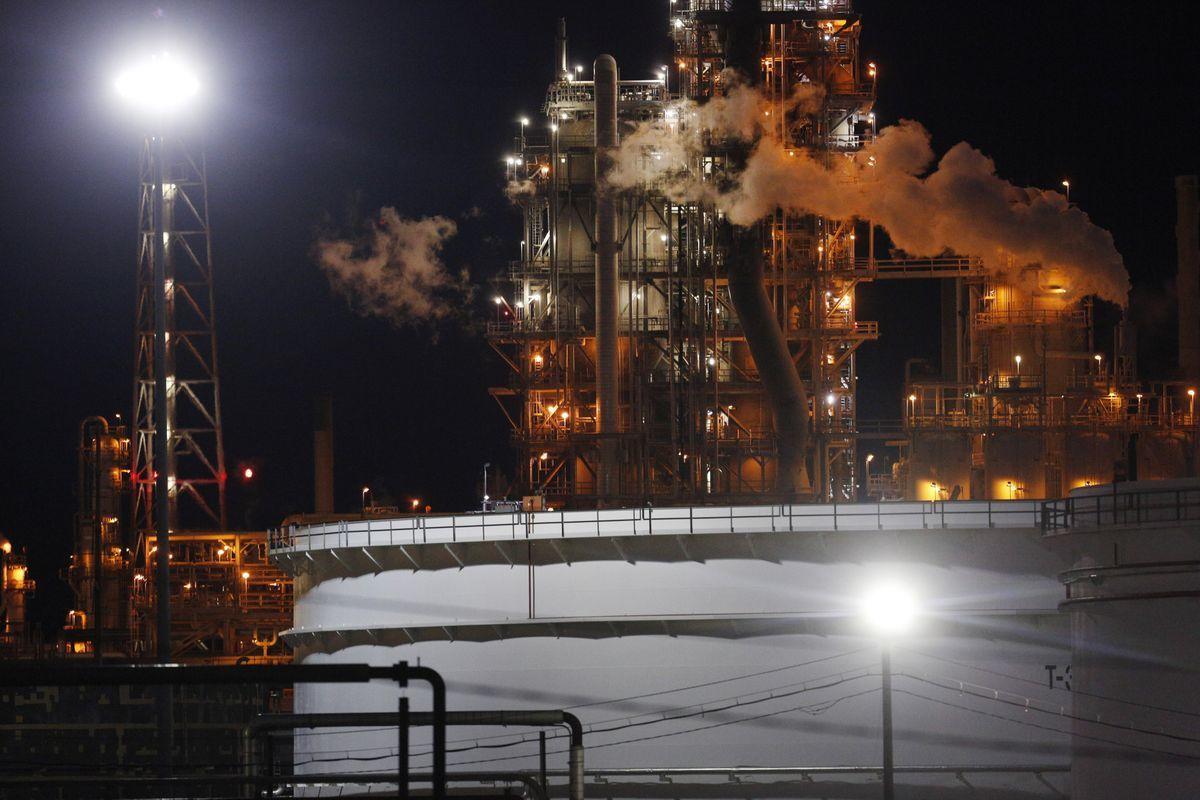 Emissions rise from the Valero Energy Corp. St. Charles Refinery at night in Norco, Louisiana, U.S. Photographer: Luke Sharrett/Bloomberg