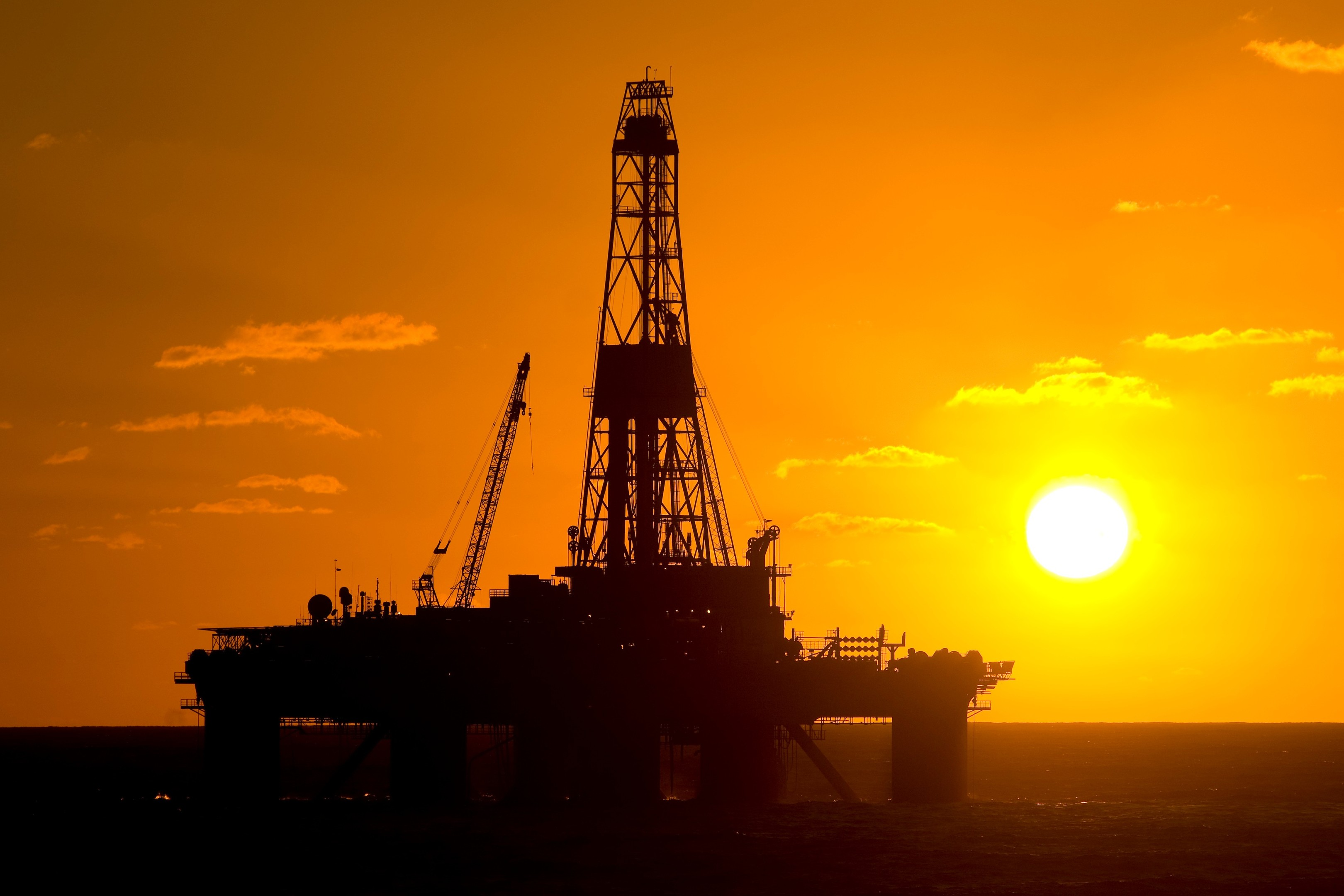 An oil rig at sunset