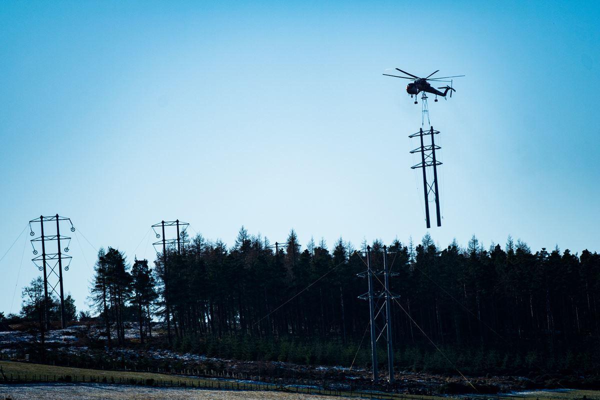 TheErickson S-64 Air Crane chopper installing poles for the Dorenell wind farm