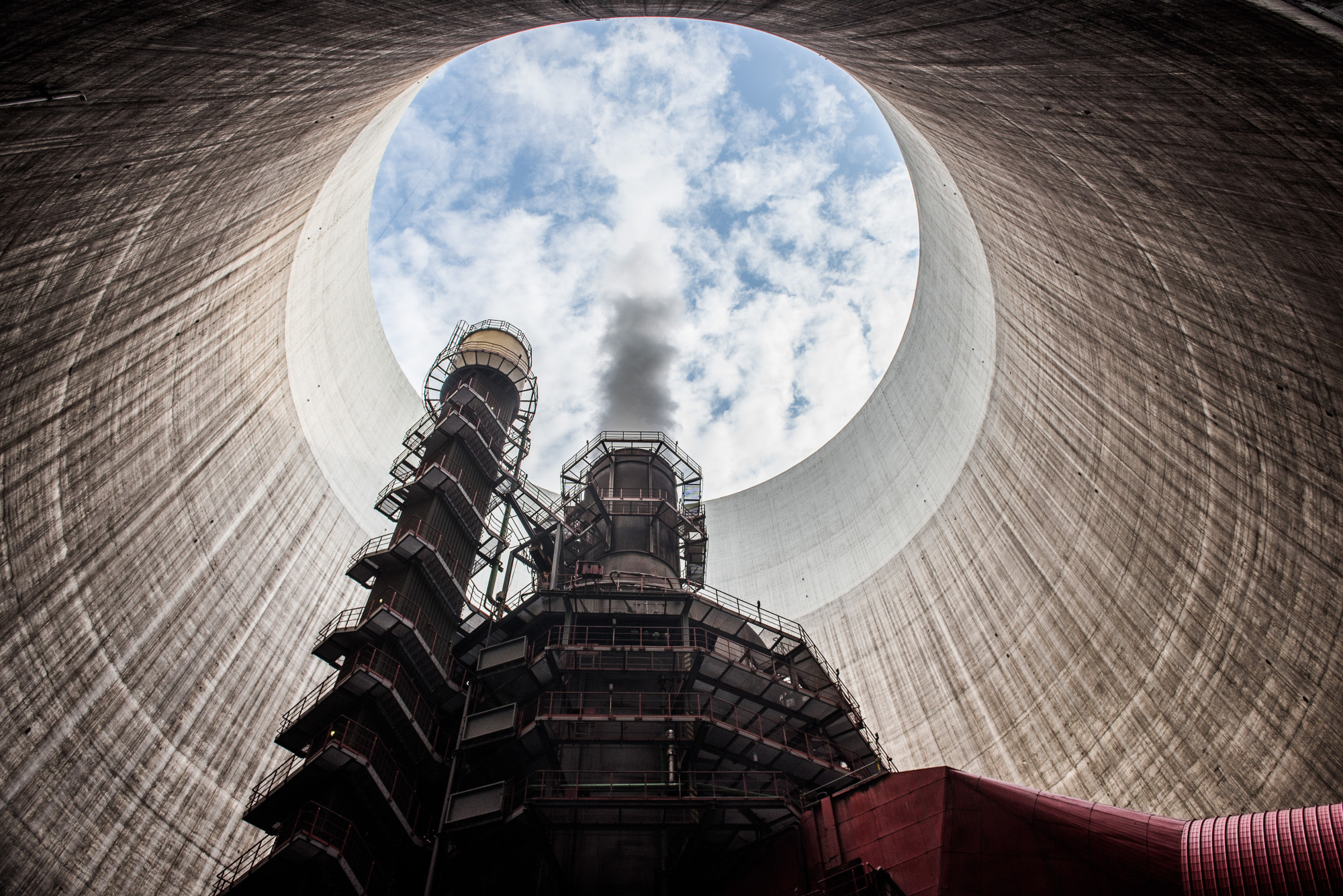 Steam rises from within a cooling tower at the Visonta coal power station, operated by Matrai Eromu Zrt, in Visonta, Hungary, on Wednesday, July 27, 2016. Coal for delivery in Europe in 2017 will fall about 11 percent by December, taking the gloss off the longest rally in year-ahead prices since 2010, according to a survey of traders and analysts by Bloomberg. Photographer: Akos Stiller/Bloomberg