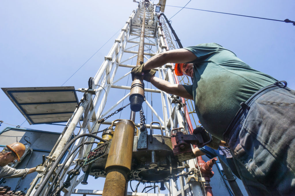 A worker inserts a drill tube into a rotary mantle on a gas rig during drilling operations by DK Ukrgazvydobuvannya (UGV), a unit of NAK Naftogaz Ukrainy, in Poltava, Ukraine, on Friday, July 21, 2017. Investors wanting to take the temperature of Ukraine's reform drive could do worse than look in on state-run energy firm Naftogaz, where a battle for control underscores the obstacles hampering wider efforts to clean up the ex-communist economy. Photographer: Vincent Mundy/Bloomberg