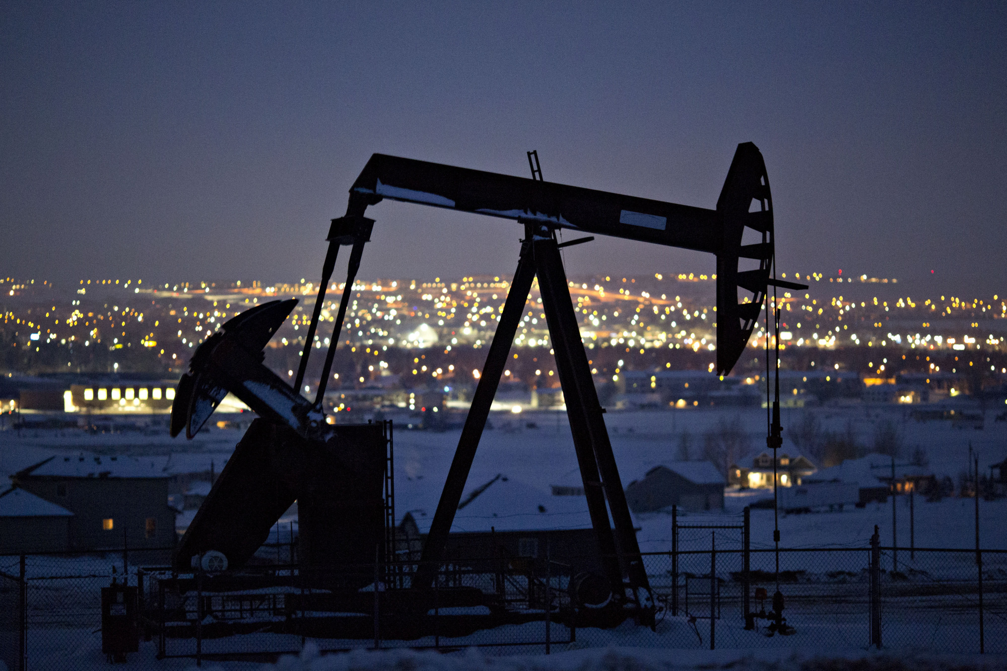 A pumpjack operates above an oil well at night in the Bakken Formation on the outskirts of Williston, North Dakota, U.S., on Thursday, March 8, 2018. Photographer: Daniel Acker/Bloomberg