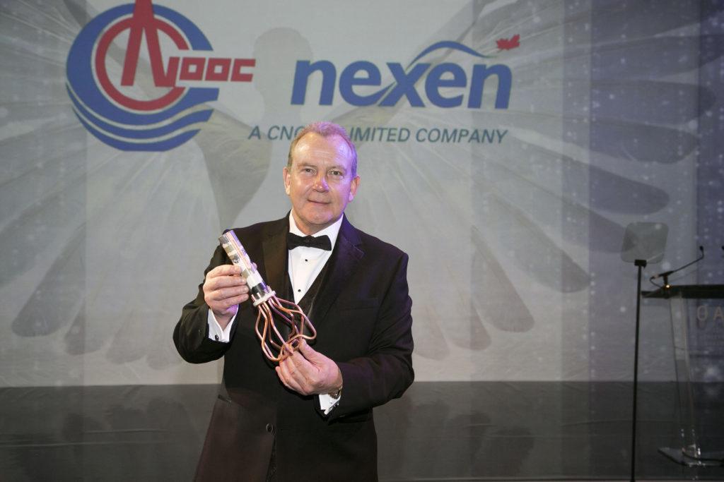 Ray Riddoch with his award