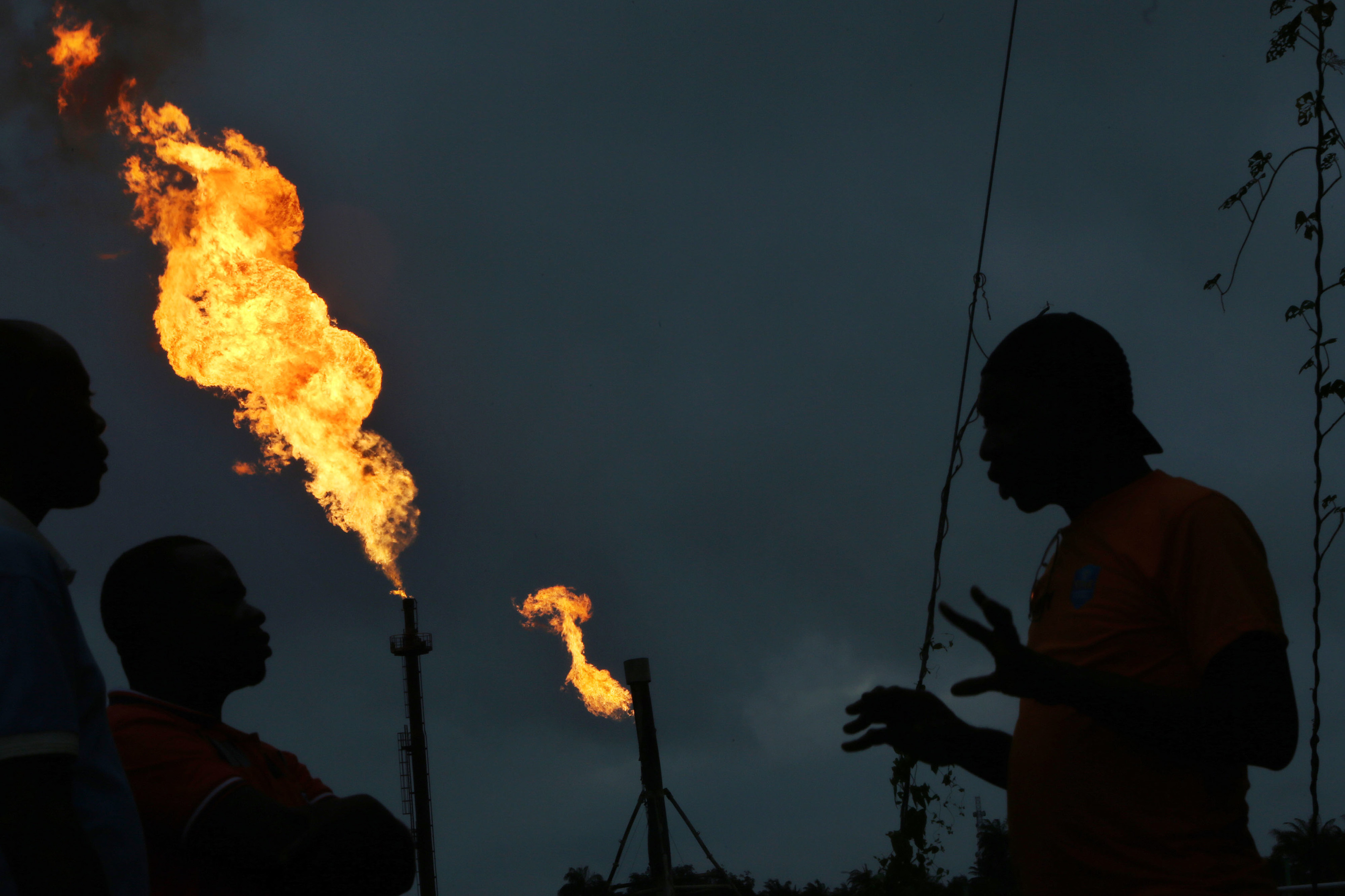 Gas flares burn from pipes at an oil flow station operated by Nigerian Agip Oil Co. Ltd. (NAOC), a division of Eni SpA, in Idu, Rivers State, Nigeria, on Monday, Sept. 28, 2015.  Photographer: George Osodi/Bloomberg