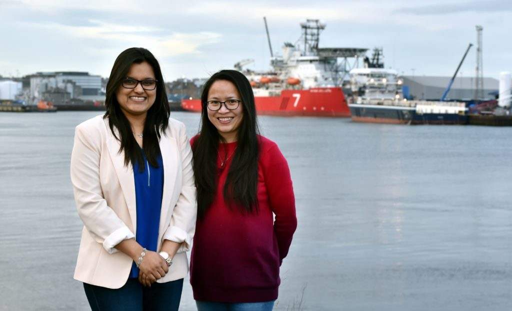 Ritika Pawar (left) and Lien Ta with Aberdeen Harbour in the background. Picture by COLIN RENNIE February 16, 2018.