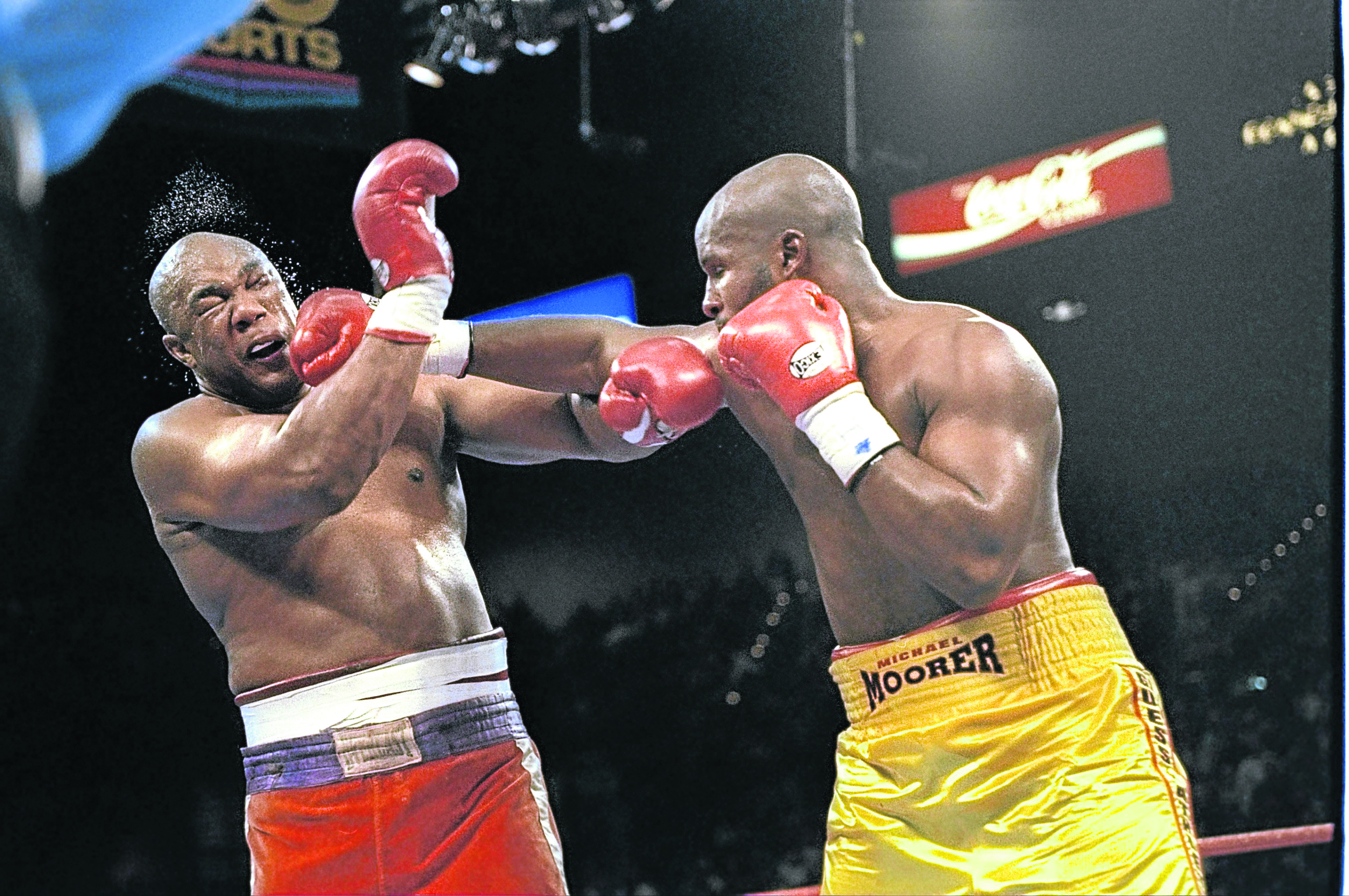 The way that the 45-year-old George Foreman, left, came back from this battering by Michael Moorer in Las Vegas 24 years ago has inspired the theme of the Energy Voice event