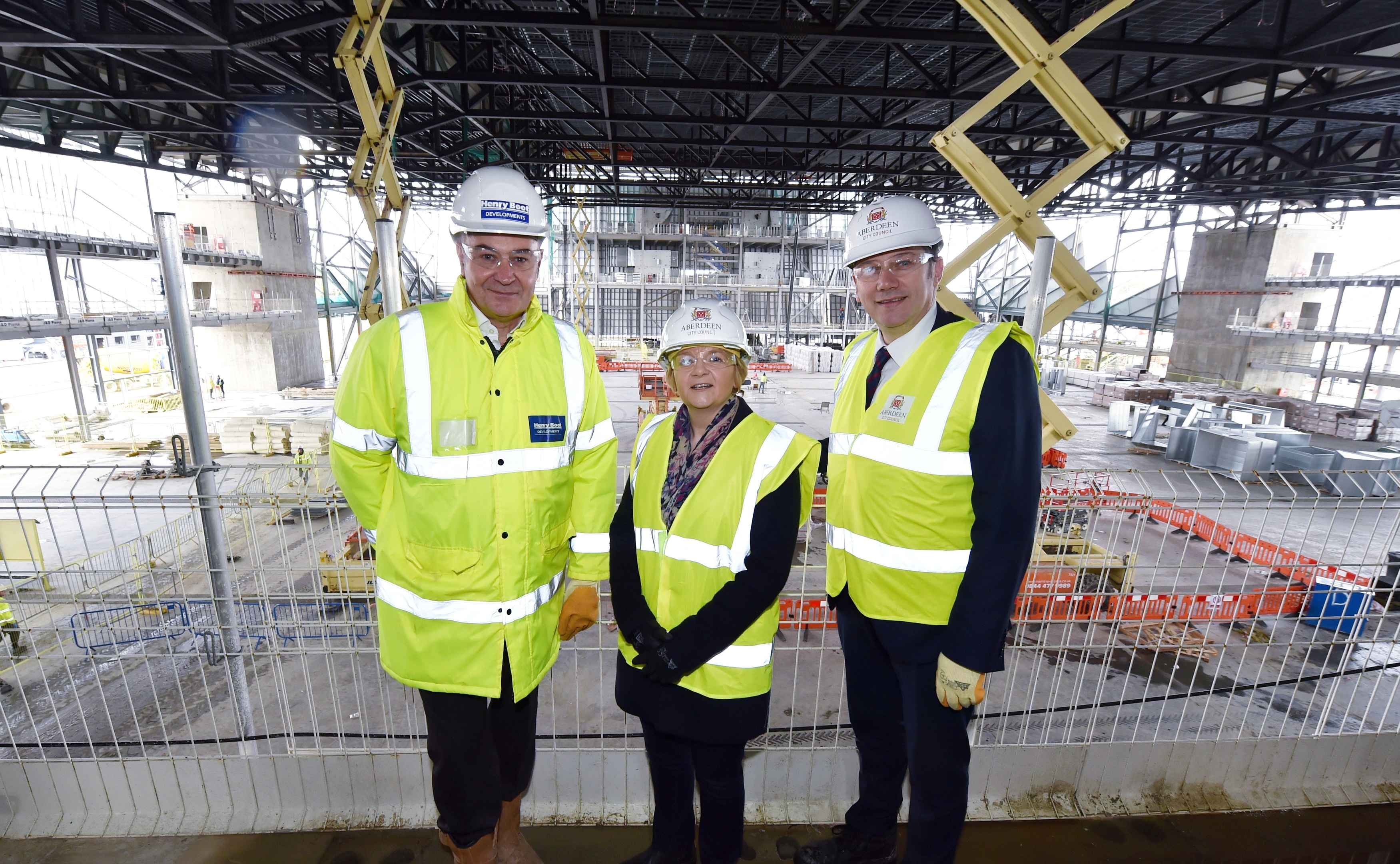 Work continues on the new AECC in Aberdeen as the building programme passes the halfway stage. (from left) Nigel Munro, regional project manager at Henry Boot Development, Aberdeen City Council Co-Leader Councillor Jenny Laing and Co-Leader Douglas Lumsden. Picture by COLIN RENNIE  March 13, 2018.