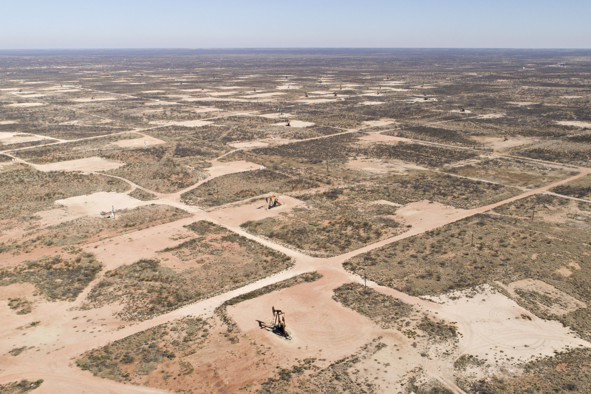 Pumpjacks operate on oil wells in the Permian Basin. Photographer: Daniel Acker/Bloomberg
