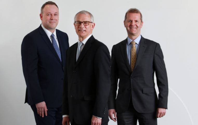 Alan Simpson with Anderson Strathern chairman Bruce Farquhar and energy group head Neil Farrell.