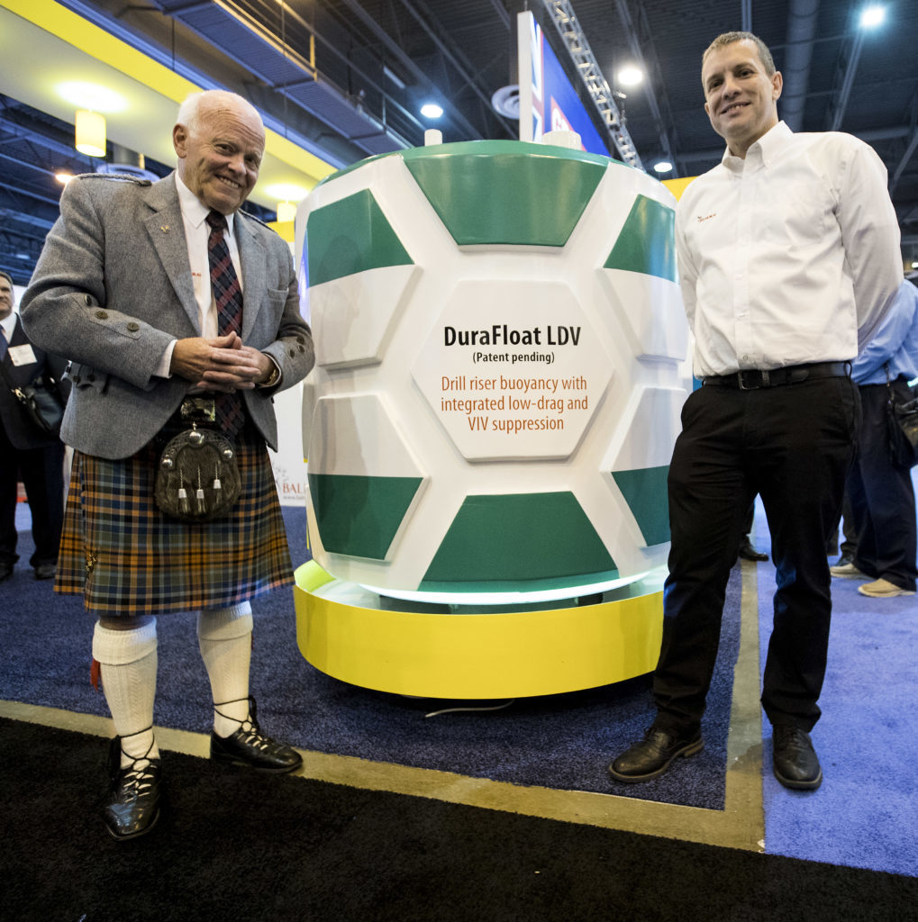 Jim Milne, managing director, Balmoral Group, left, and Fraser Milne, engineering and projects director of Balmoral Offshore Engineering, pose for a photo after unveiling the Durafloat LDV, deepwater riser buoyancy system, during the 50th Offshore Technology Conference on Monday, April 30, 2018, in Houston. ( Brett Coomer / Houston Chronicle )