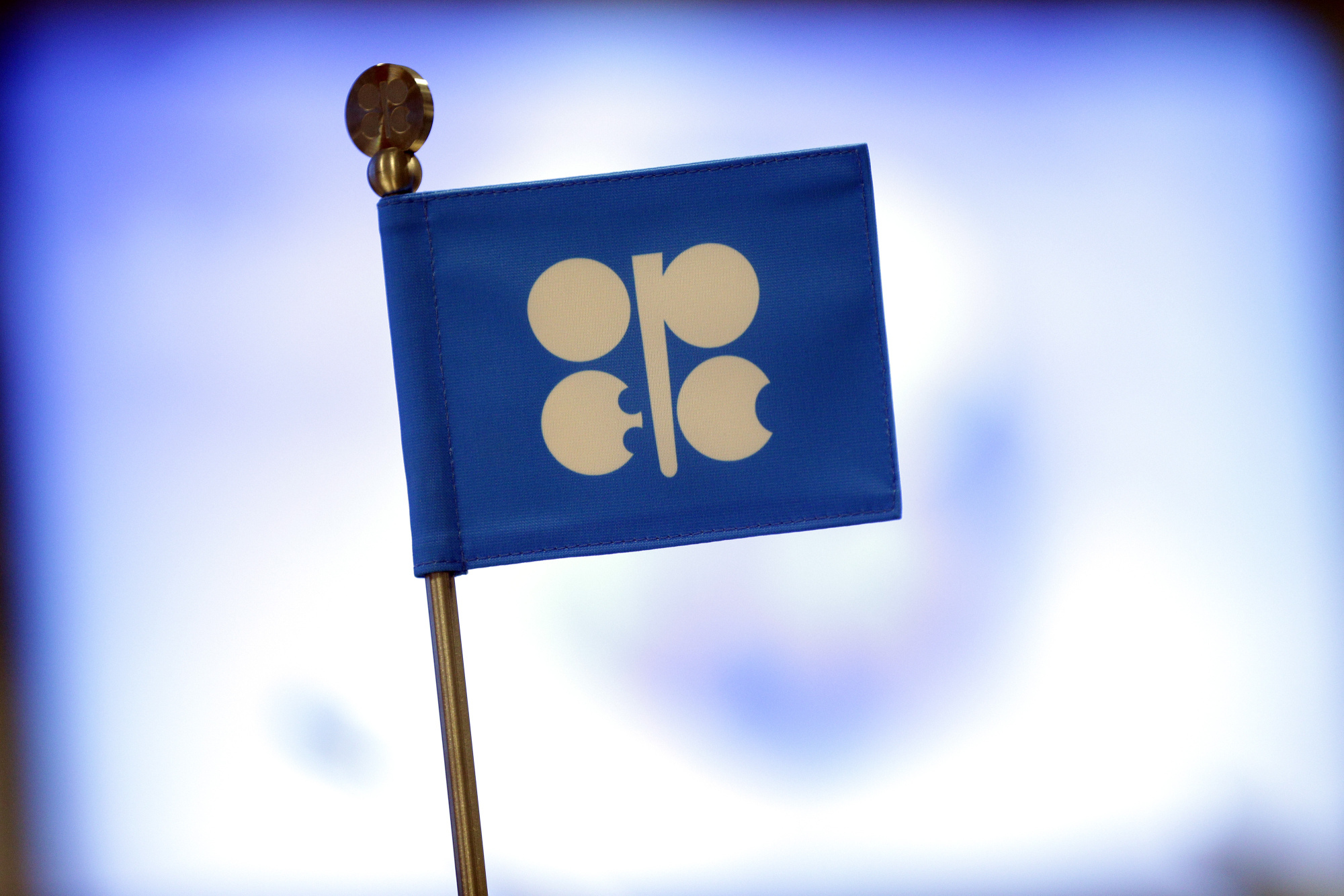 The flag of the Organization of Petroleum Exporting Countries (OPEC) stands on a desk during a news conference at the OPEC Secretariat in Vienna, Austria. Photographer: Lisi Niesner/Bloomberg