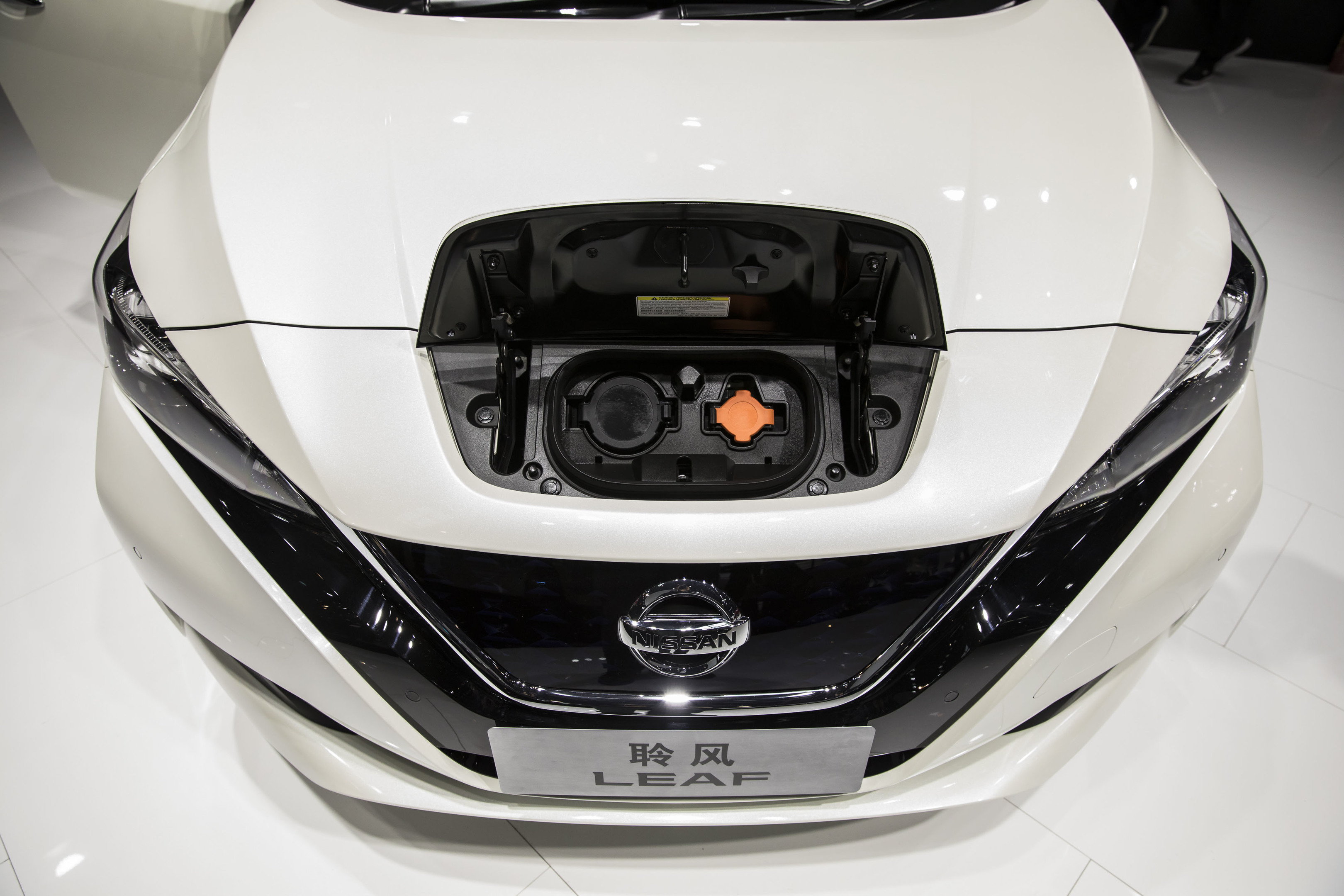 A Nissan Motor Co. Leaf electric vehicle stands on display at the Beijing International Automotive Exhibition in Beijing. Photographer: Qilai Shen/Bloomberg
