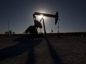 The silhouette of an oil pump jack is seen in Texas, U.S. Photographer: Bloomberg Creative Photos/Bloomberg