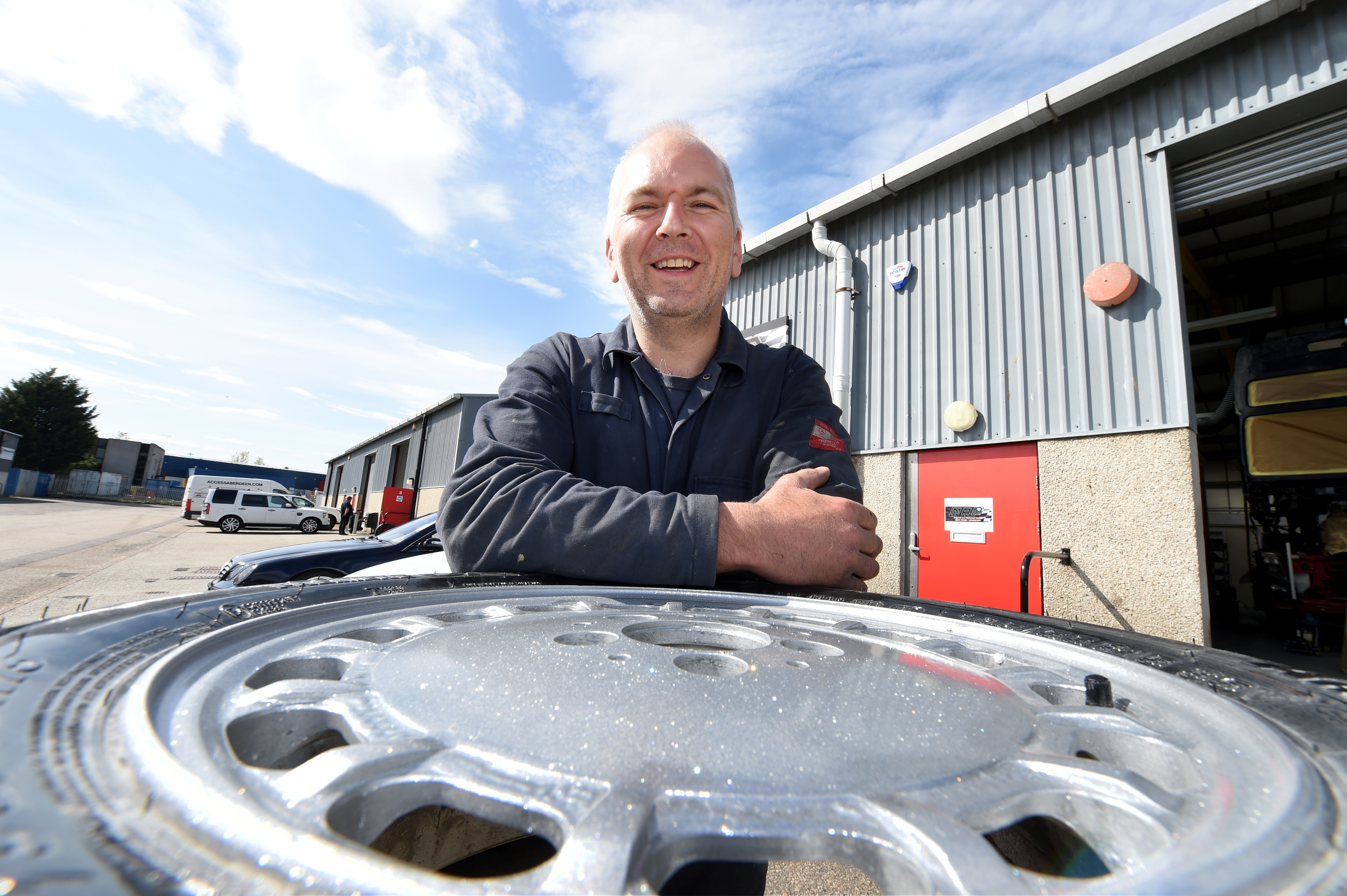 Morgan Prosser, MAP Autoshop Dyce with his paint for alloy wheels.