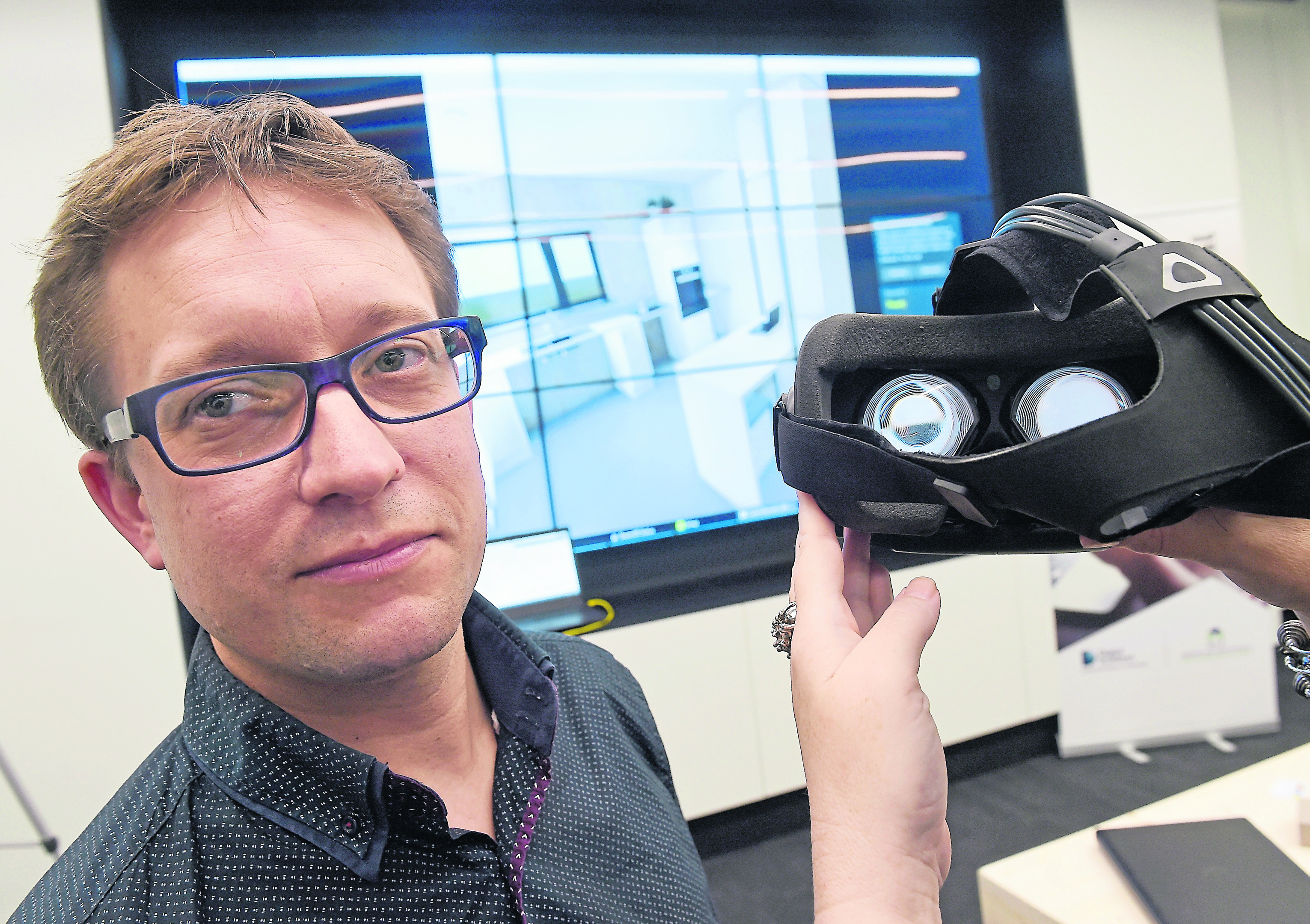 Picture by SANDY McCOOK   17th June '16  Matt Stevenson of Carbon Dynamic, based in Invergordon with the virtual reality version of a home they are developing for Albyn Housing.  The event was held yesterday at the HIE enterprise and research facility on the UHI Campus.