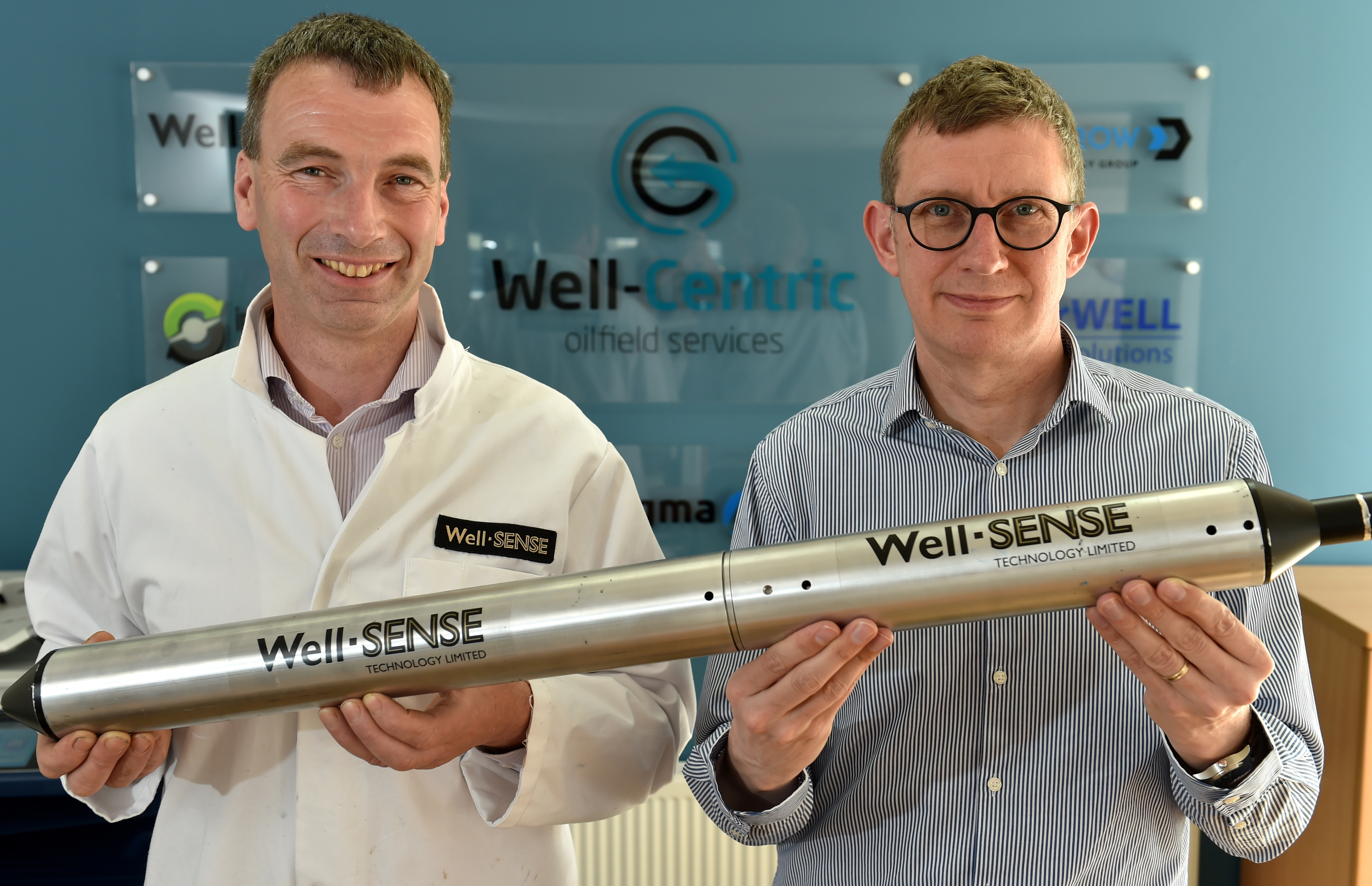 (L-R) Dan Purkis, technology director at Well-Sense Technology, and Stuart Ferguson, chief executive of FrontRow Energy Techology Group, holding an FLI system.