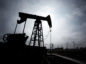 A pumpjack is silhouetted as it operates in Baku, Azerbaijan, on Sunday, March 18, 2018. Two years after descending into junk, Azerbaijan's shortest path to winning back its investment grade is by rebuilding the stash of petrodollars it raided during a recession and a banking meltdown, according to Fitch Ratings. Photograph: Taylor Weidman/Bloomberg Photographer: Taylor Weidman/Bloomberg