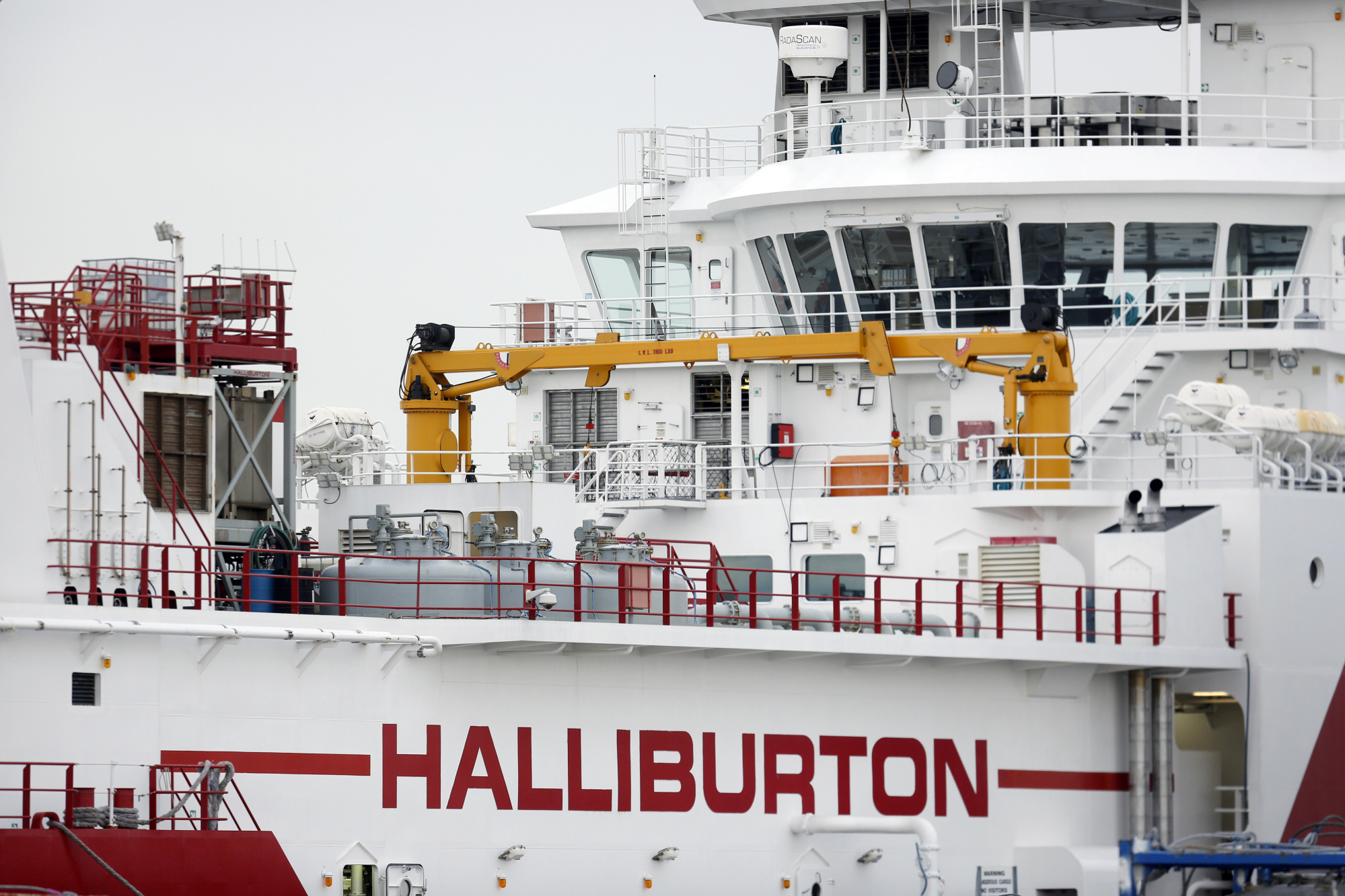 A Halliburton Co. petroleum industry vessel sits docked in Port Fourchon, Louisiana, U.S., on Thursday, Feb. 8, 2018. Photographer: Luke Sharrett/Bloomberg