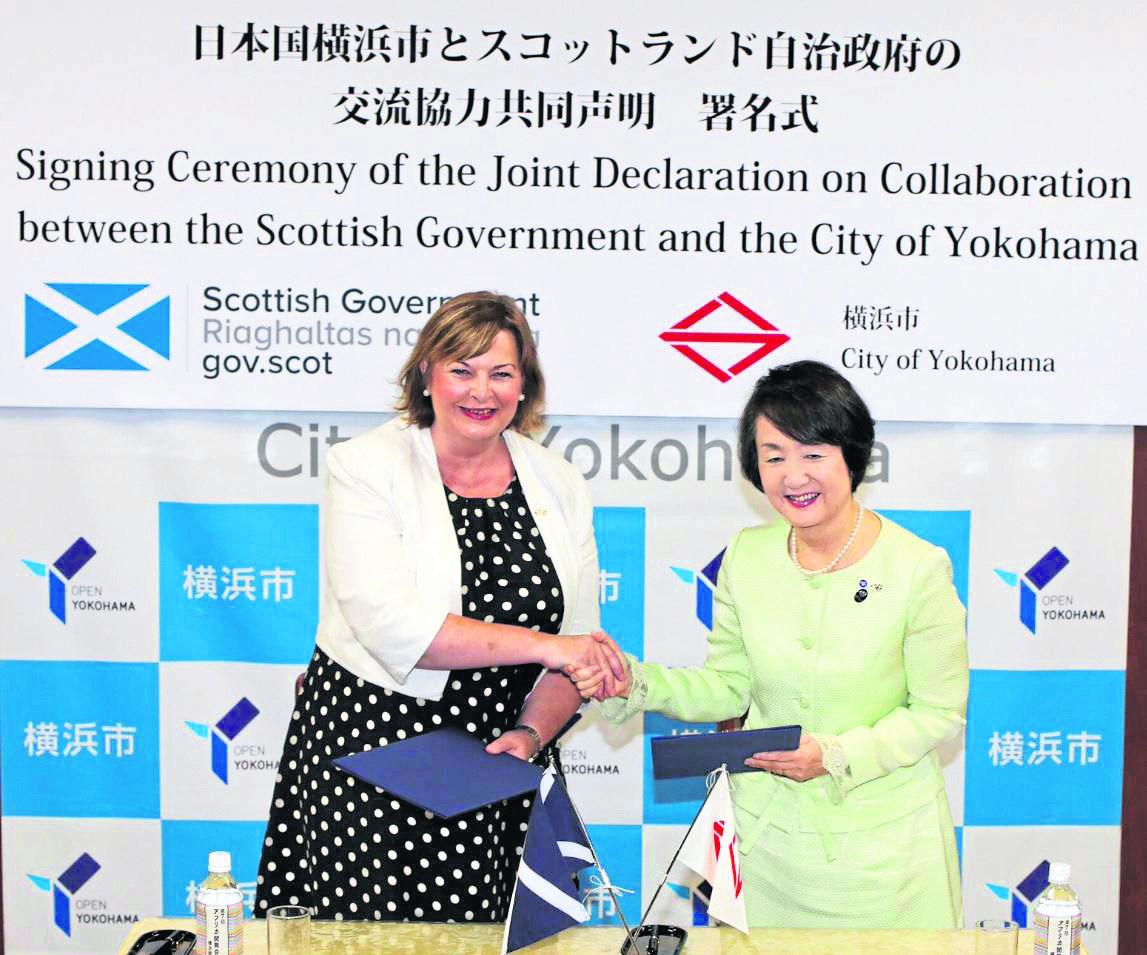 DEAL: External Affairs Secretary Fiona Hyslop shakes hands on the agreement for closer links with Yokohama mayor Fumiko Hayashi