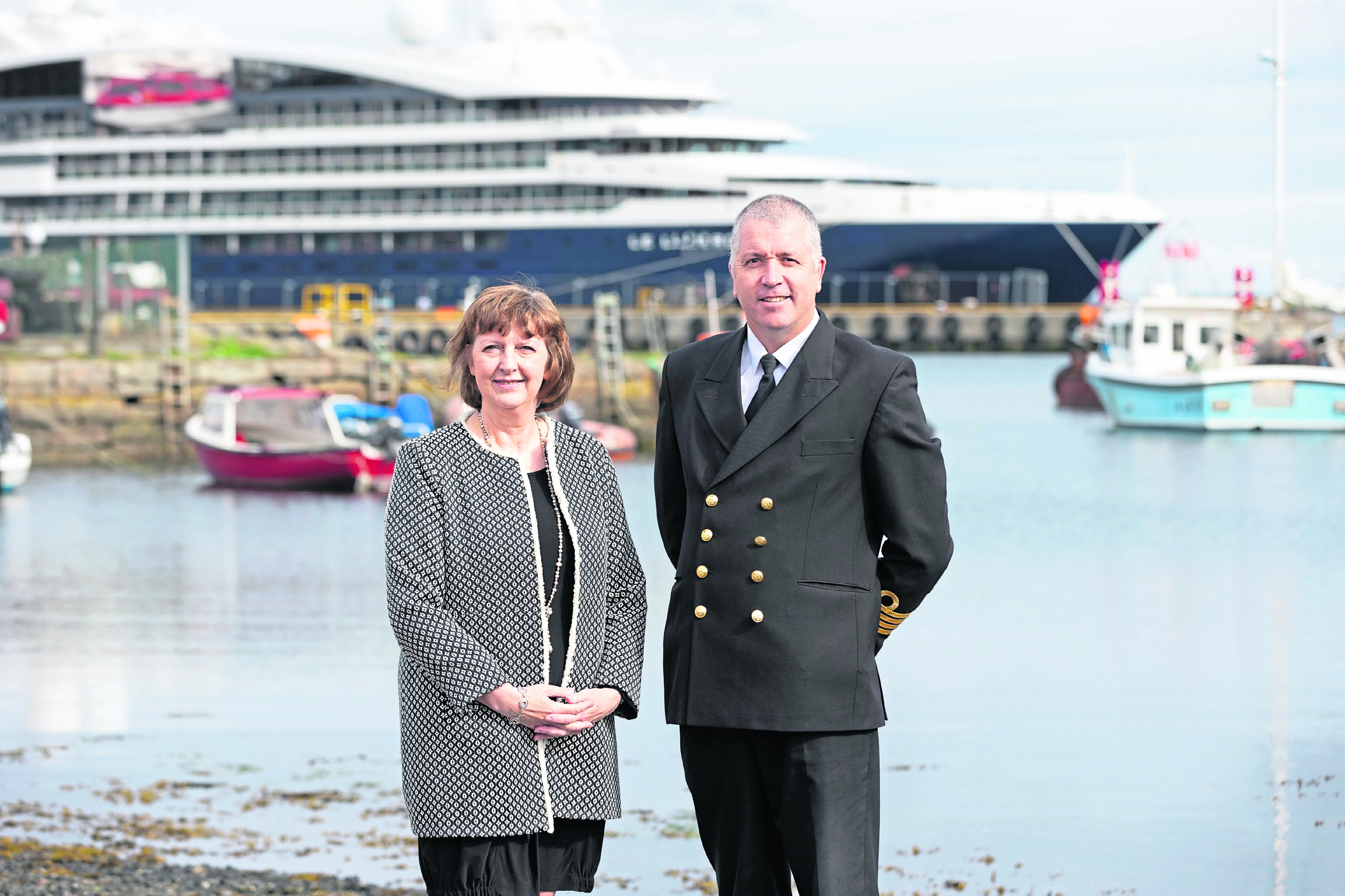 Lerwick Port Authority's Sandra Laurenson,   and her successor-designate as Chief Executive, Captain Calum Grains, with the cruise ship, Le Laperouse, in the background