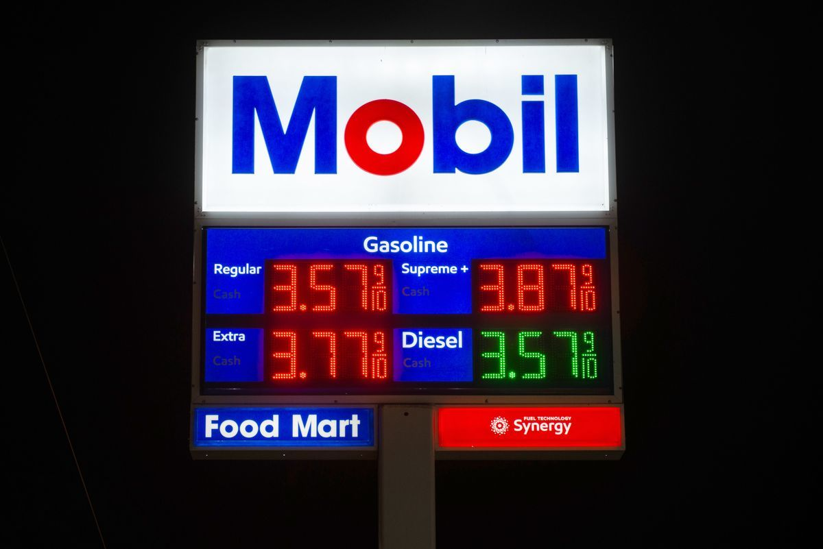 Signage displays fuel prices at an Exxon Mobil Corp. gas station at night in Seattle, Washington, U.S. Photographer: Chona Kasinger/Bloomberg