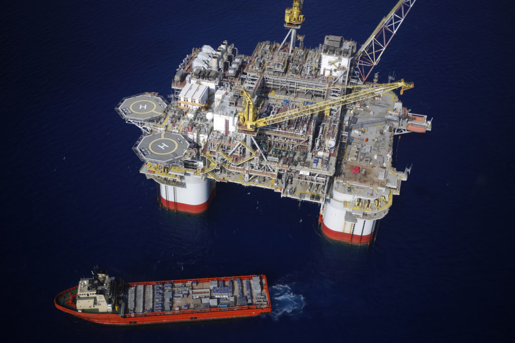 The Kobe Chouest platform supply vessel sits anchored next to the Chevron Corp. Jack/St. Malo deepwater oil platform in the Gulf of Mexico in the aerial photograph taken off the coast of Louisiana, U.S., on Friday, May 18, 2018. Photographer: Luke Sharrett/Bloomberg