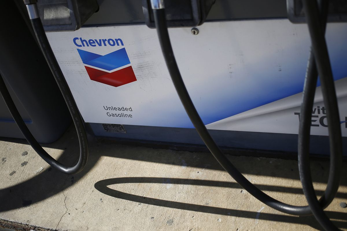 Signage is displayed on a fuel pump at a Chevron Corp. gas station in Guild, Tennessee, U.S., on Tuesday, Jan. 24, 2017. Chevron Corp. is expected to release earnings figures on January 27. Photographer: Luke Sharrett/Bloomberg