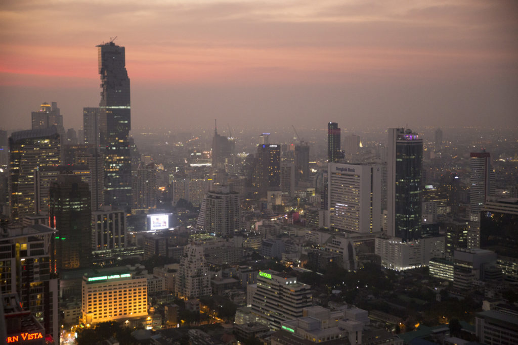 Buildings stand illuminated at dusk in the Sathorn district of Bangkok, Thailand, on Monday, Jan. 30, 2017. Thailand's central bank held its key interest rate near a record low to shield the nation's economic recovery as the threat of trade protectionism mounts. Photographer: Brent Lewin/Bloomberg