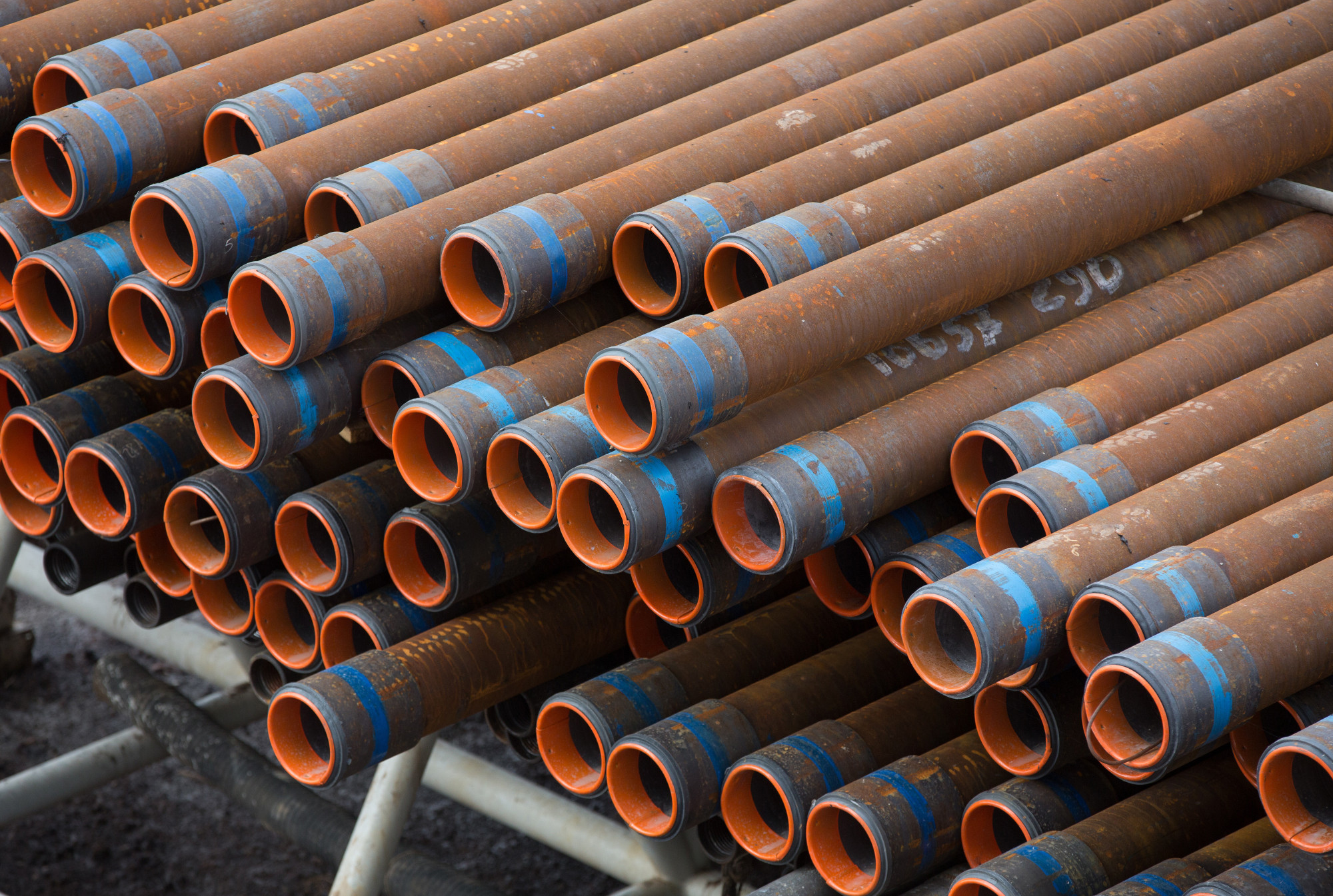 Drill pipe sections sit in storage beside a drill rig during oil drilling operations by Targin JSC, a unit of Sistema PJSFC, in an oilfield operated by Bashneft PAO near Ufa, Russia, on Thursday, Sept. 29, 2016. Bashneft distributes petroleum products and petrochemicals around the world and in Russia via filling stations. Photographer: Andrey Rudakov/Bloomberg