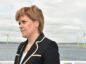 """First Minister Nicola Sturgeon has said she will """"convene a summit"""" over the fairness of wind farm contracts."""