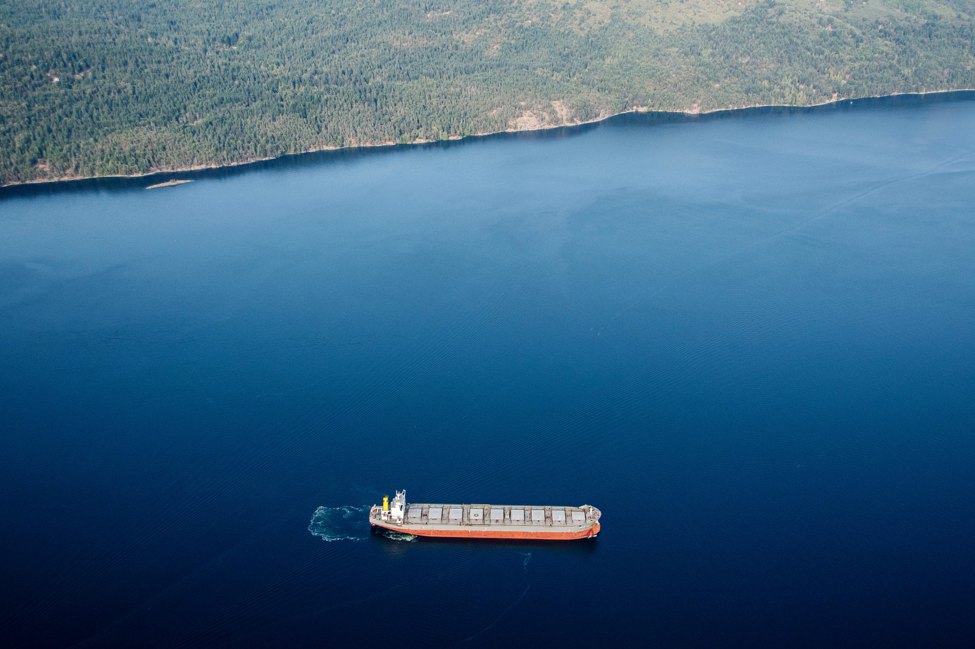 A tanker ship sits anchored in this aerial photograph taken above Saanich Inlet, British Columbia, Canada, on Sunday, Aug. 12, 2018. Canada is scheduled to release its second-quarter gross domestic product (GDP) figures on August 30. Photographer: James MacDonald/Bloomberg