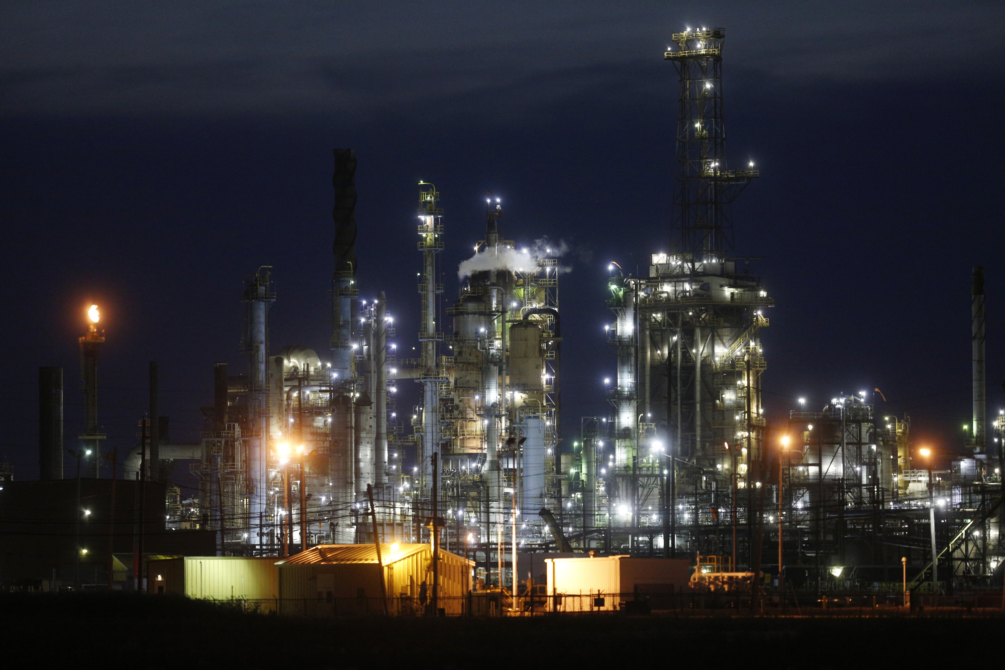 "The BP-Husky Toledo Refinery stands at night in Oregon, Ohio, U.S., on Tuesday, June 13, 2017. Global natural gas production stagnated last year as lower prices damped U.S. output for the first time since the shale boom started. Gas production was ""adversely affected by low prices, growing by only 0.3 percent,"" BP Plc said in its annual Statistical Review. Photographer: Luke Sharrett/Bloomberg"