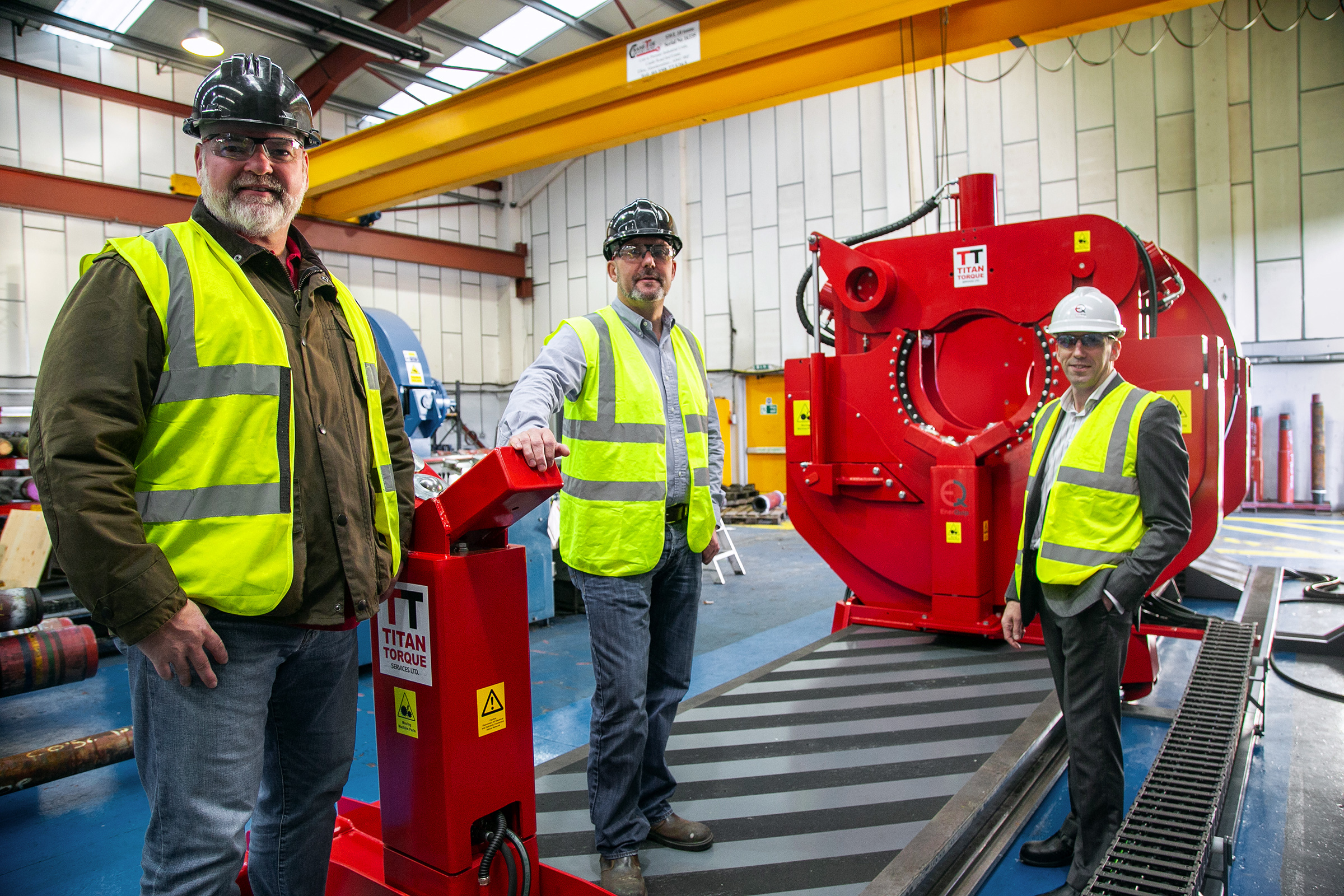Titan directors Bruce Jepp (left) and Keith Gaskin, with Barry Marshall, business development director at EnerQuip (right) next to the new torque machine