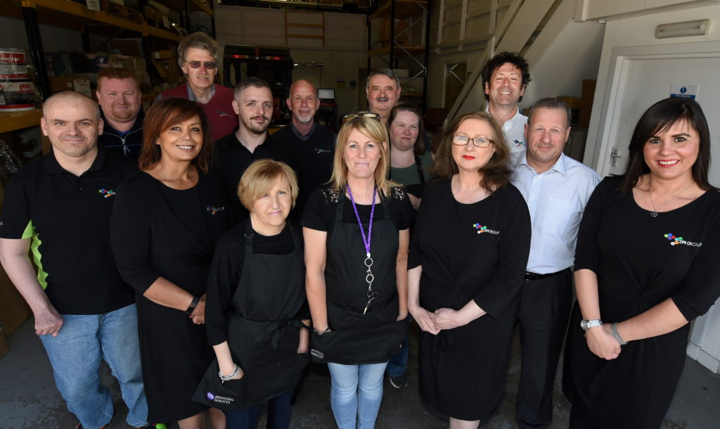 A photograph taken in May of 2M's Dyce based employees.