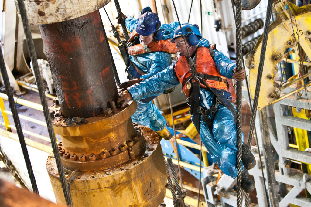 Drill crew removing bolts to collapse the slip joint on the Byford Dolphin semi-submersible drilling rig