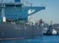 The Sea Garnet crude oil tanker is pulled by a tugboat near the El Segundo Offshore Oil Terminal in El Segundo, California, U.S. Photographer: Tim Rue/Bloomberg