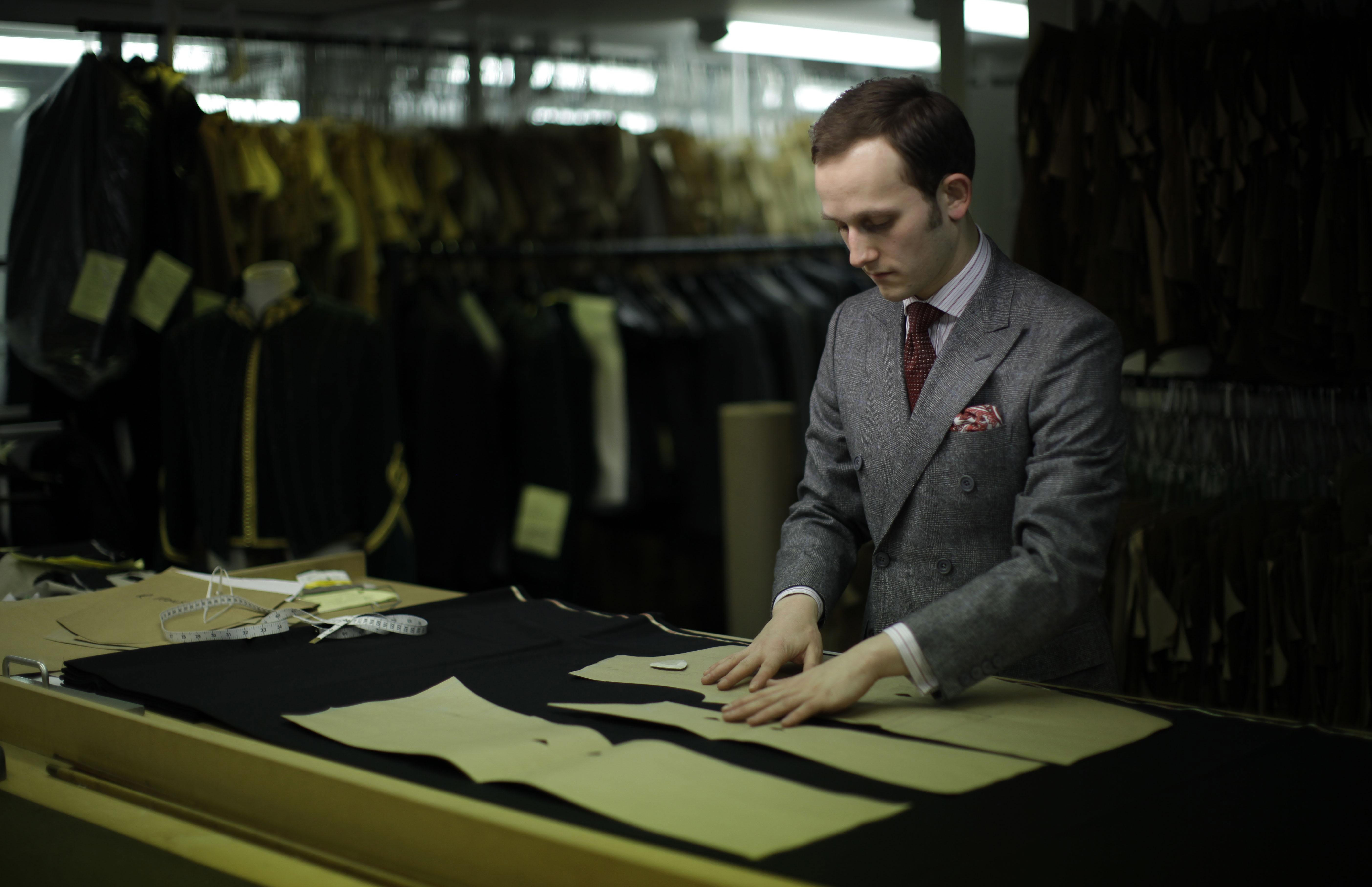 Gieves and Hawkes bespoke under cutter Richard Lawson poses for photographs at the tailor's premises on Saville Row in London