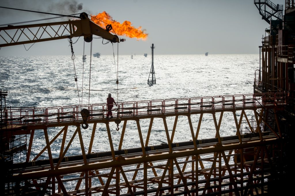 A gas flare burns from a pipe aboard an offshore oil platform in the Persian Gulf's Salman Oil Field, operated by the National Iranian Offshore Oil Co., near Lavan island, Iran, on Thursday, Jan. 5. 2017. Nov. 5 is the day when sweeping U.S. sanctions on Iran's energy and banking sectors go back into effect after Trump's decision in May to walk away from the six-nation deal with Iran that suspended them. Photographer: Ali Mohammadi/Bloomberg