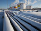 Oil pipelines and storage tanks stand in the snow at the Novokuibyshevsk oil storage plant, operated by Rosneft PJSC, in Novokuibyshevsk, Samara region, Russia, on Thursday, Dec. 22, 2016.  Photographer: Andrey Rudakov/Bloomberg