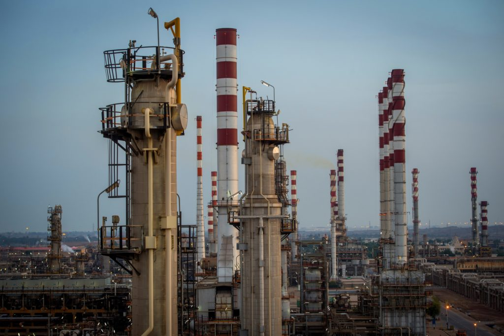 Cracking towers and chimneys stand at the processing plant at the Persian Gulf Star Co. (PGSPC) gas condensate refinery in Bandar Abbas, Iran, on Wednesday, Jan. 9. 2019. The third phase of the refinery begins operations next week and will add 12-15 million liters a day of gasoline output capacity to the plant, Deputy Oil Minister Alireza Sadeghabadi told reporters. Photographer: Ali Mohammadi/Bloomberg