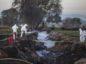 Forensic investigators examine the explosion site. Photographer: Alejandro Cegarra/Bloomberg
