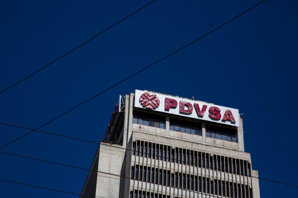 Petroleos de Venezuela SA (PDVSA) signage is displayed on a building in Puerto La Cruz, Anzoategui State, Venezuela. Photographer: Wil Riera/Bloomberg