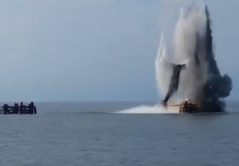 The footage shows part of platforms being blown up using explosives.