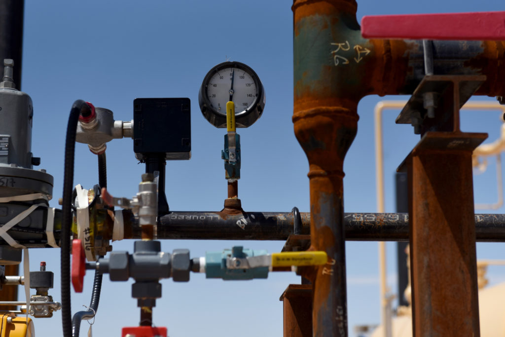 "A gas valve sits on a pipeline at the Royal Dutch Shell Plc processing facility in Loving, Texas, U.S., on Friday, Aug. 24, 2018. Royal Dutch Shell Plc came through a quarter of volatile oil prices to beat earnings estimates, delivering a surge in cash flow the company said will underpin ""world-class"" returns to investors. Photographer: Callaghan O'Hare/Bloomberg"