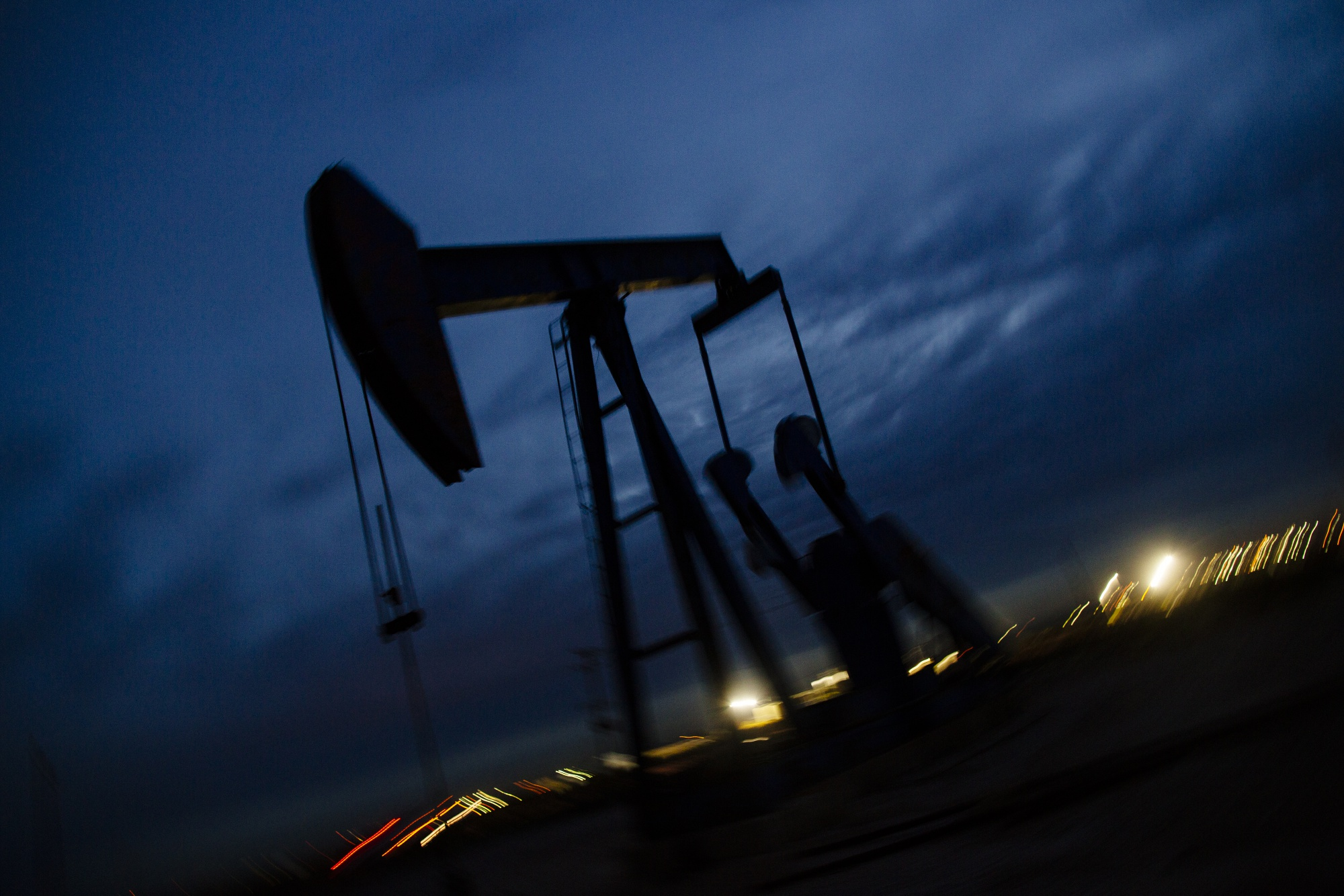 A pump jack stands at dusk in the Permian Basin area of Loving County, Texas, U.S., on Sunday, Dec. 16, 2018. Photographer: Angus Mordant/Bloomberg