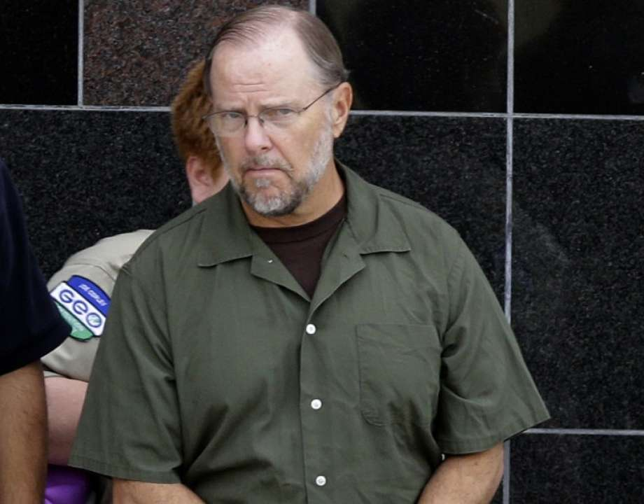 Former Enron CEO Jeffrey Skilling leaves the federal courthouse Friday, June 21, 2013, in Houston after being resentenced for his role in the energy giants' collapse. Skilling was resentenced to 14 years as part of a court-ordered reduction and a separate agreement with prosecutors. He was released in February 2019.