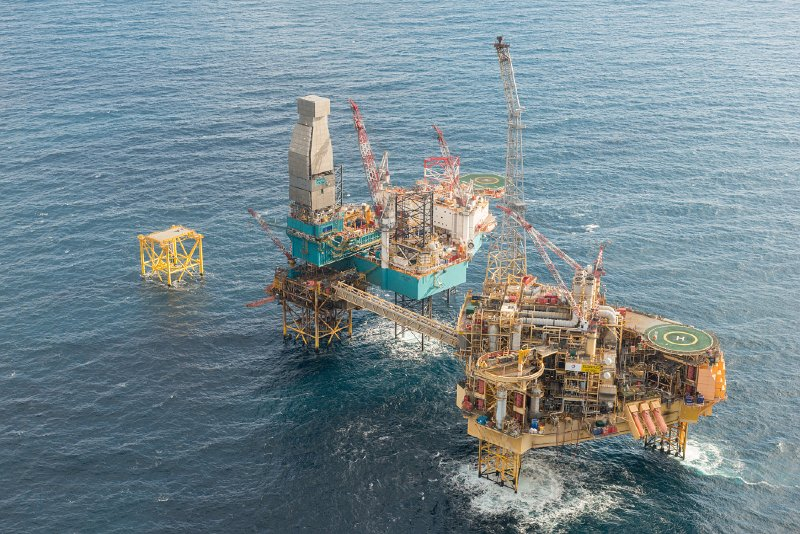 Total's Elgin PUQ platform, pictured right, alongside a Valaris rig.