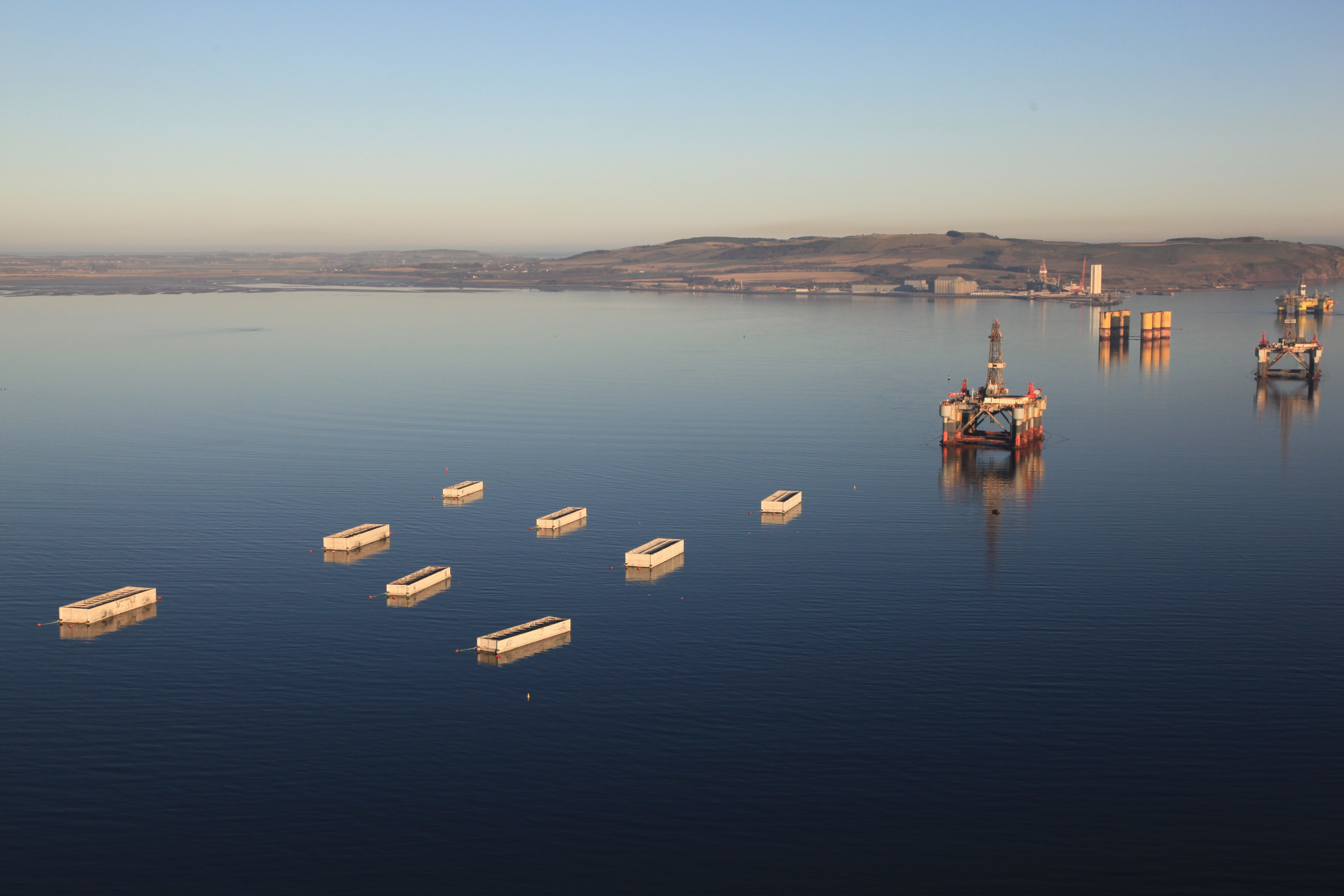 The first of the 22 concrete caissons has left Cromarty Firth on a 180-nautical mile journey to Aberdeen harbour